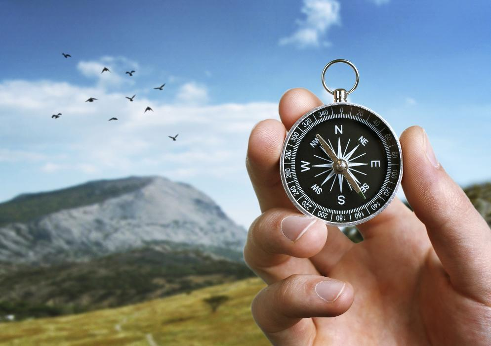 Person holding compass in the mountains | Lifespan Integration Seattle WA