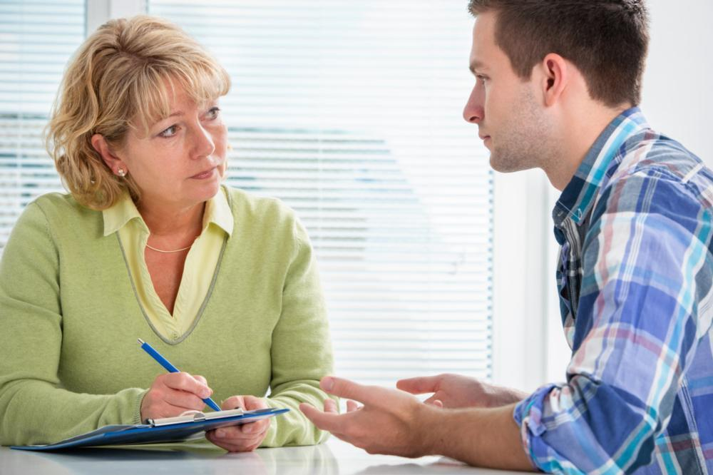 Woman therapist and male patient